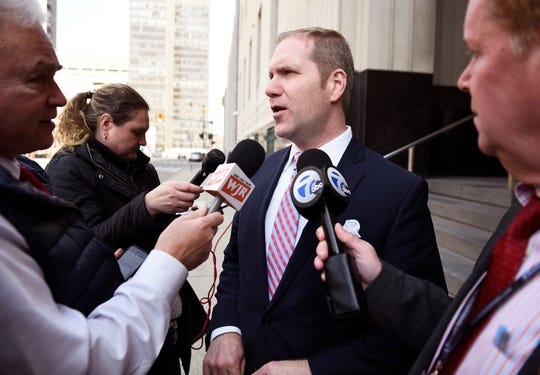 U.S. Attorney for the Eastern District of Michigan Matthew J. Schneider talks to reporters at the end of the hearing Tuesday for former UAW Vice President Norwood Jewell.