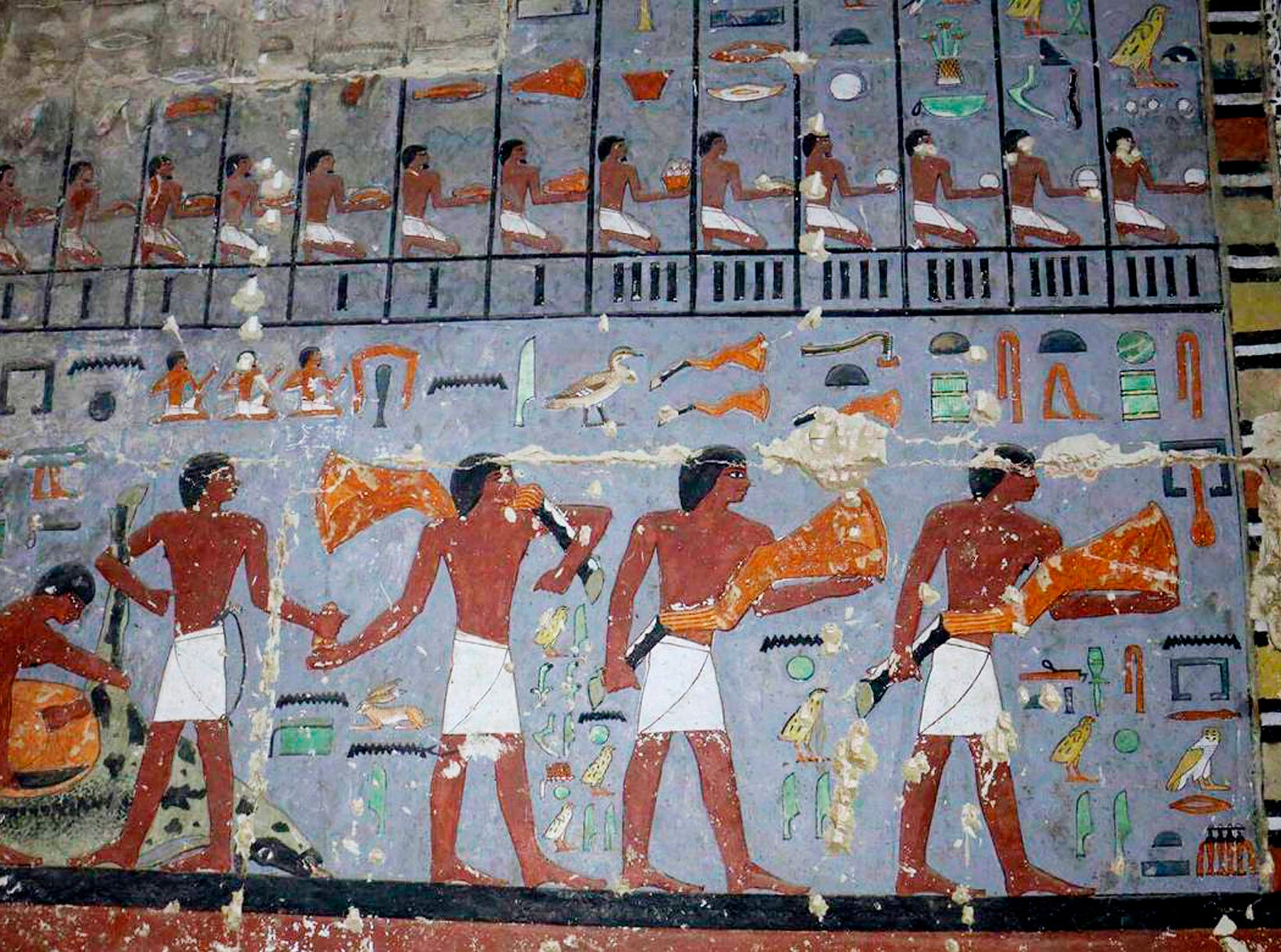 This photo released Tuesday, April 2, 2019, by the Egyptian Ministry of Antiquities, shows pharaonic paintings in the tomb of a noble from the time of one of the earliest pharaonic dynasties, in Saqqara, Giza, Egypt. The Antiquities Ministry said Tuesday that the tomb uncovered in the Saqqara pyramids complex outside Cairo dates to the 5th Dynasty, which ruled the Nile Valley from 2388-2356 B.C. Egypt frequently touts new archaeological finds, hoping to encourage tourism.