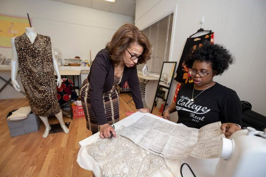Seamstress Gwen Gordon, left, owner of Design Sewing Studio, helps Cynthia Miller of West Bloomfield during a class at the studio in Farmington Hills.