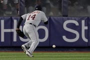 Detroit Tigers left fielder Christin Stewart (14) chases down the ball after committing a fielding error on a ball hit by New York Yankees' Greg Bird allowing a run to score during the third inning.