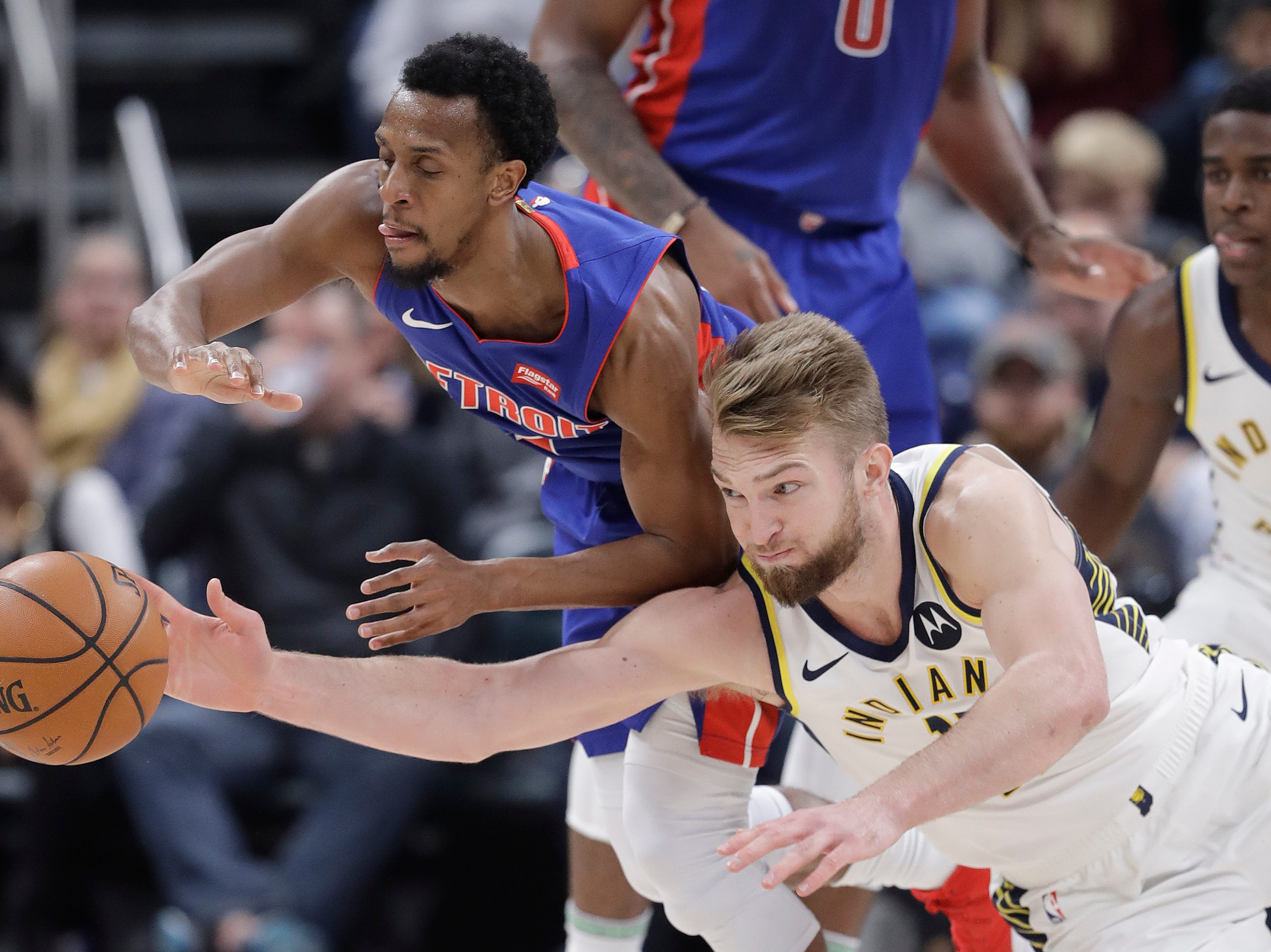 Detroit Pistons' Ish Smith, left, and Indiana Pacers' Domantas Sabonis battle for a loose ball during the second half.