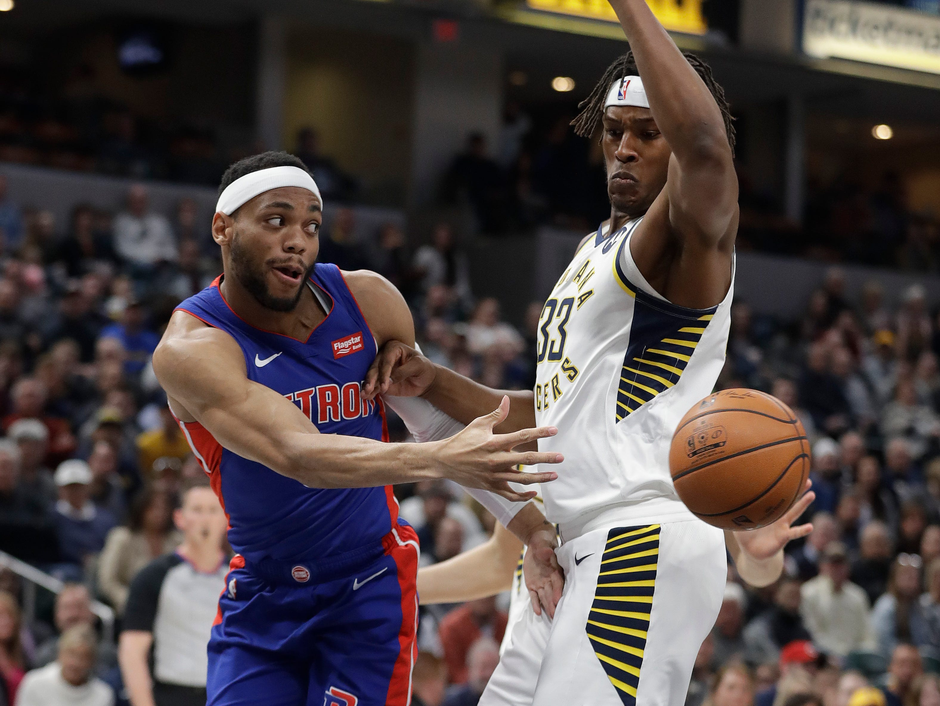 Detroit Pistons' Bruce Brown (6) makes a pass against Indiana Pacers' Myles Turner (33) during the first half.