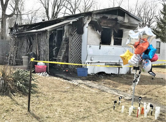 A makeshift memorial sits outside a Town of Horseheads mobile home where one person died in a fire Monday morning.