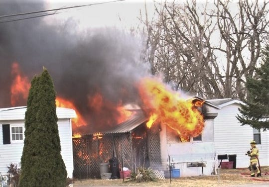 Flames erupt from a mobile home Monday morning at a trailer park in the Town of Horseheads. One person died in the fire.
