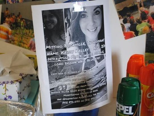 A missing person sign for Kristy Kelley hanging in a window at Studio Bee Community Center in Boonville, Ind., in 2014.