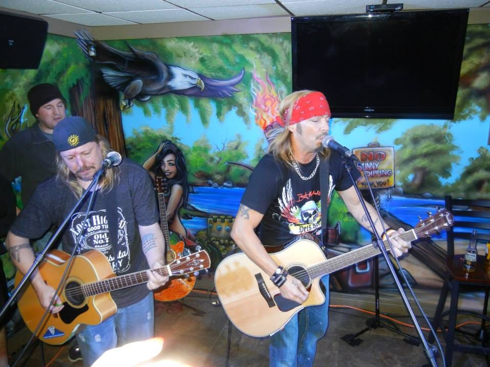 Bret Michaels, with accompaniment from guitarist Pete Evick, left, plays a private show for about 100 lucky invitees in 2014 at The Sand Box in Green Bay.