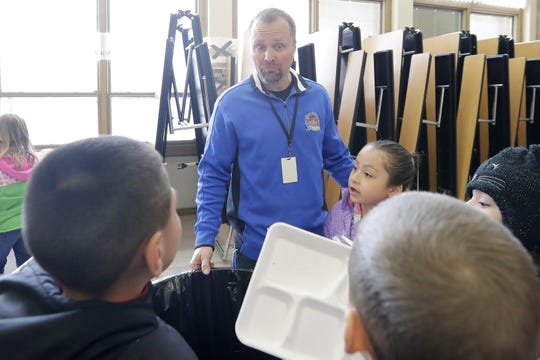 Sullivan Elementary's Micah Bootz, finalist for the Cintas' Custodian of the Year award, talks with first-grade students in the lunchroom on March 27 in Green Bay.