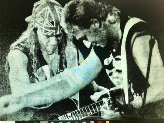 "Bret Michaels, left, sings ""Every Rose Has Its Thorn"" with Packers quarterback Don Majkowski in 1990 for the Flesh & Blood Tour launch at Brown County Veterans Memorial Arena."