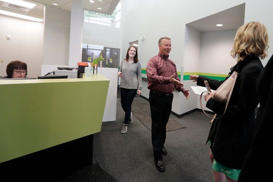 Jon Syndergaard, executive director of CP,  greets Shopko Public Relations Manager Michelle Hansen as she delivers a final check for CP on Tuesday. Shopko is winding down its charitable foundation as the company goes out of business.