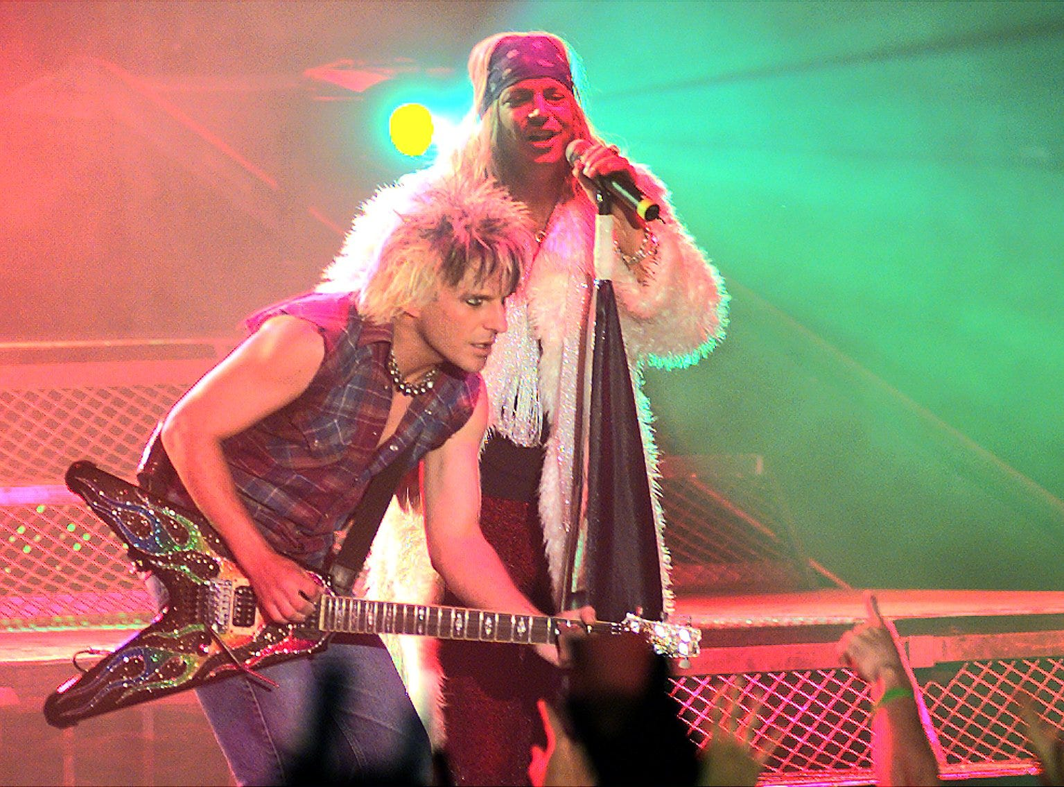 Lead singer Bret Michaels, right, takes to the stage with guitarist C.C. DeVille during Poison's sold-out performance at Oneida Bingo & Casino's Pavilion Nights in 2001.