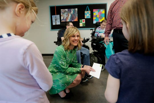 Shopko Public Relations Manager Michelle Hansen greets children after delivering a $25,000 check from the Shopko Foundation to CP on Tuesday.