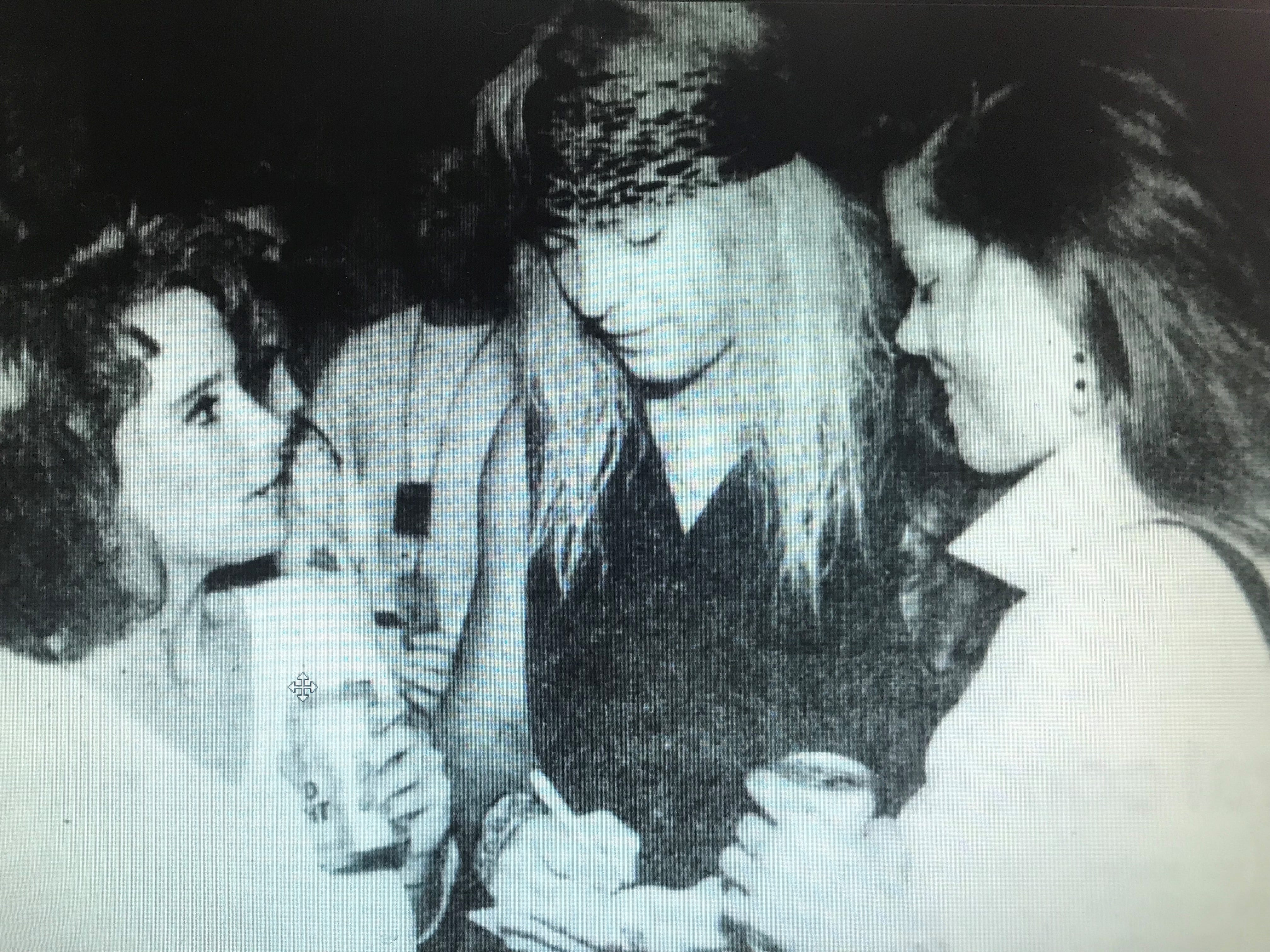 Maggie Furlong and Kim Thayer chat with Bret Michaels during Poison's rehearsal party at Brown County Veterans Memorial Arena in 1993.