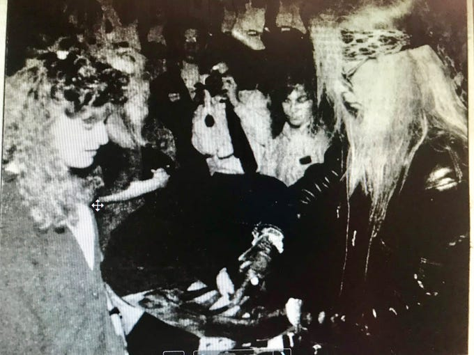 Poison frontman Bret Michaels signs autographs at Henri's Music in 1990.