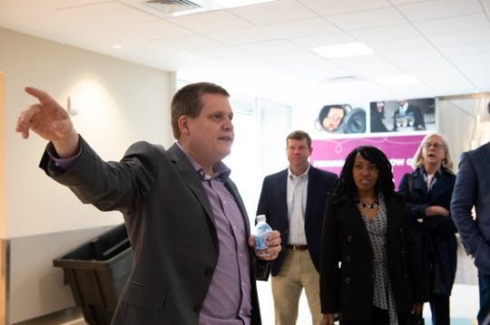 Scott Carr, vice president of commercial business and communications at Greenville-Spartanburg International Airport, leads members of the Tallahassee community around the airport for a tour the Tuesday, April 2, 2019.