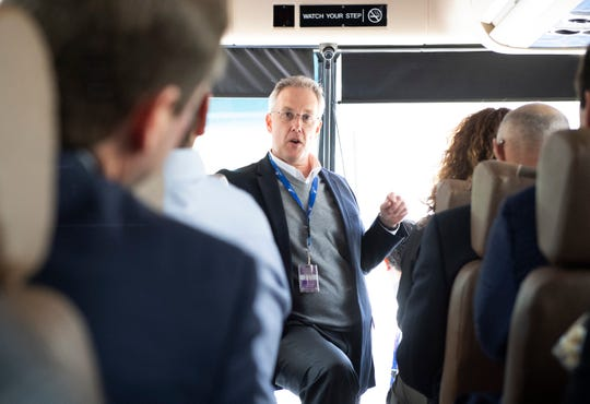 Tom Tyra, director of marketing at Greenville-Spartanburg International Airport, talks to community members from Tallahassee about GSP during a bus tour Tuesday, April 2, 2019.