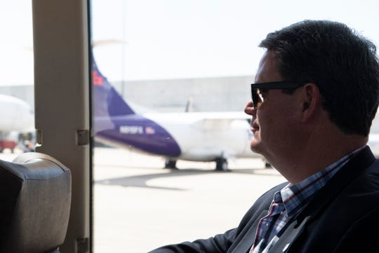 Tallahassee Mayor John Dailey rides a bus on a tour of the Greenville-Spartanburg International Airport Tuesday, April 2, 2019.