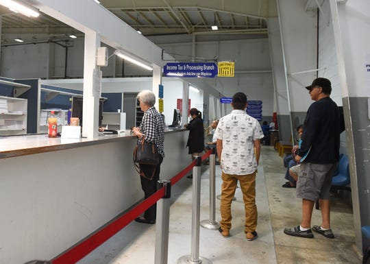 Tax filers line up at the Income Tax and Processing Branch at the Guam Department of Revenue and Taxation in Barrigada, April 2, 2019.