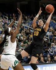 "Iowa's Megan Gustafson (10) shoots against Baylor's Kalani Brown (21) during the Bears' 85-53 win Monday night in Greensboro, N.C. It probably speaks to Gustafson's fantastic career that 23 points and nine rebounds were considered an ""off"" night by her standards."