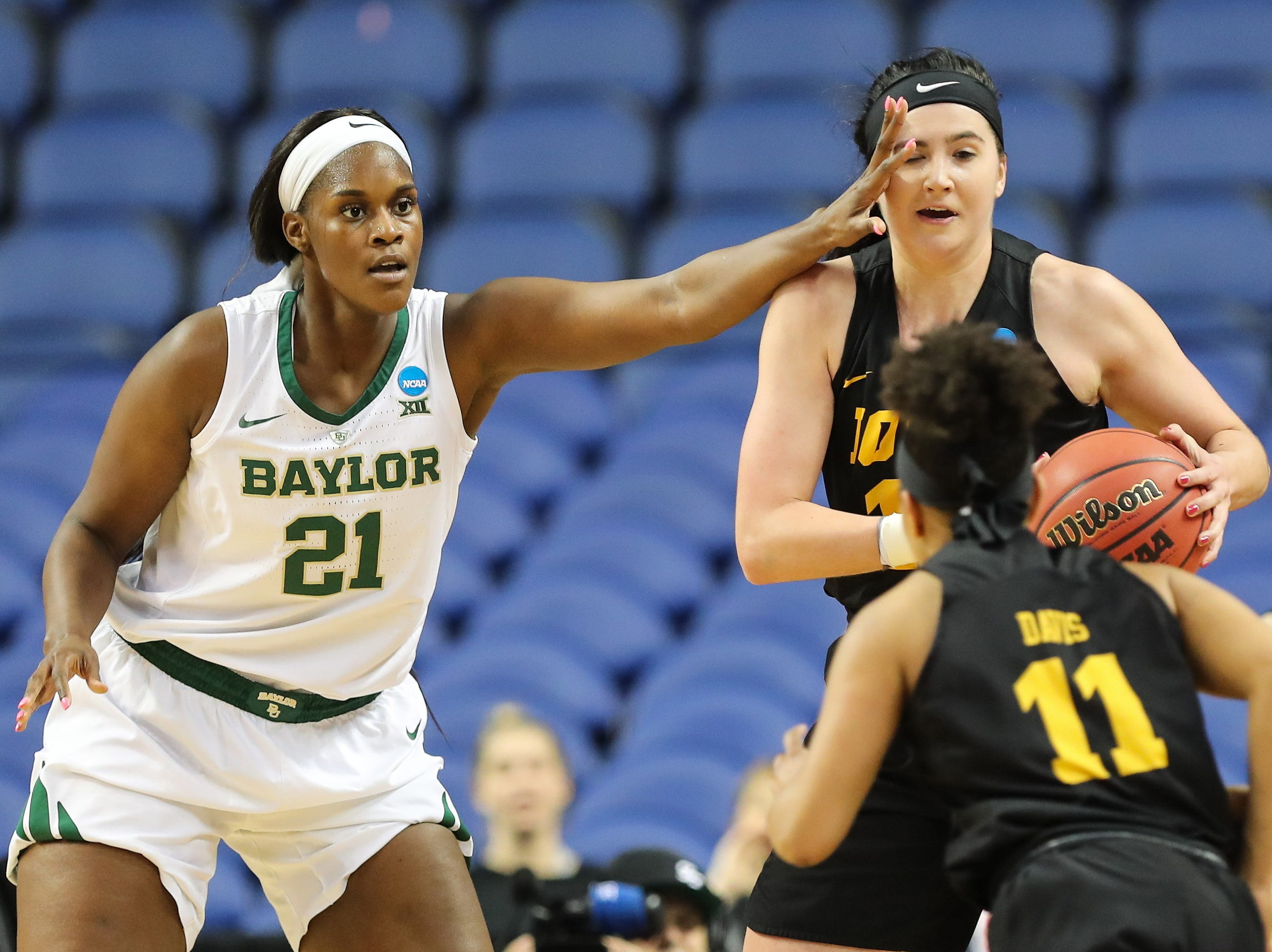 Iowa Hawkeyes forward Megan Gustafson (10) gets bumped by Baylor Lady Bears center Kalani Brown (21) during the first half in the championship game of the Greensboro regional in the women's 2019 NCAA Tournament at the Greensboro Coliseum.
