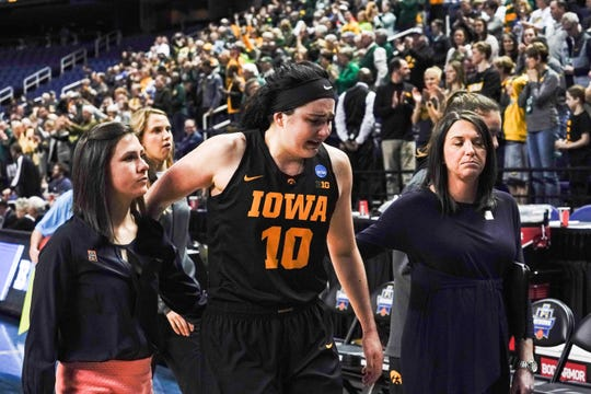 Megan Gustafson exits the floor after her final game as a Hawkeye.