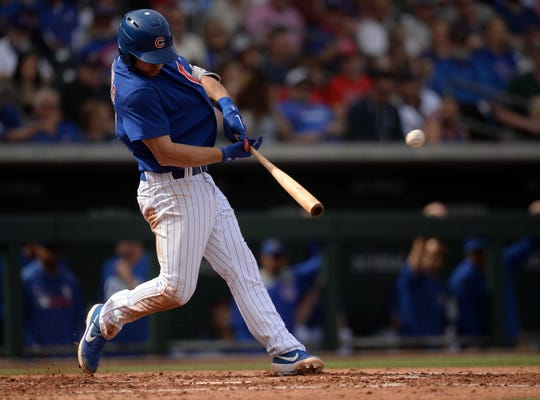 Chicago Cubs shortstop Nico Hoerner (24) hits a two run home run against the Los Angeles Angels during the third inning at Sloan Park.