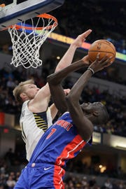 Detroit Pistons' Thon Maker (7) is fouled by Indiana Pacers' Domantas Sabonis (11) as he goes up for a shot during the first half of an NBA basketball game, Monday, April 1, 2019, in Indianapolis.