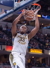 Indiana Pacers center Myles Turner (33) scores with a slam-dunk during the second half of an NBA basketball game against the Orlando Magic, Saturday, March 30, 2019, in Indianapolis.