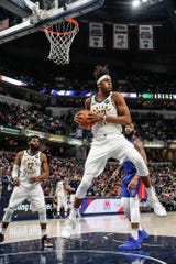 Indiana Pacers center Myles Turner (33) grabs a rebound during a game between the Indiana Pacers and the Detroit Pistons at Bankers Life Fieldhouse on Monday, April 1, 2019. leftIndiana Pacers guard Tyreke Evans (12), right, Detroit Pistons center Andre Drummond (0).