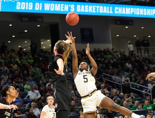 Apr 1, 2019; Chicago, IL, USA; Notre Dame Fighting Irish guard Jackie Young (5) shoots over Stanford Cardinal forward Alanna Smith (11) during the second half in the championship game of the Chicago regional in the women's 2019 NCAA Tournament at Wintrust Arena.
