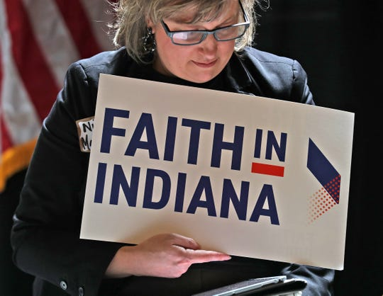 Nicole MacLaughlin listens during the Faith in Action rally, at the Statehouse, Tuesday, April 2, 2019, to raise awareness about potential changes that could impact healthcare.