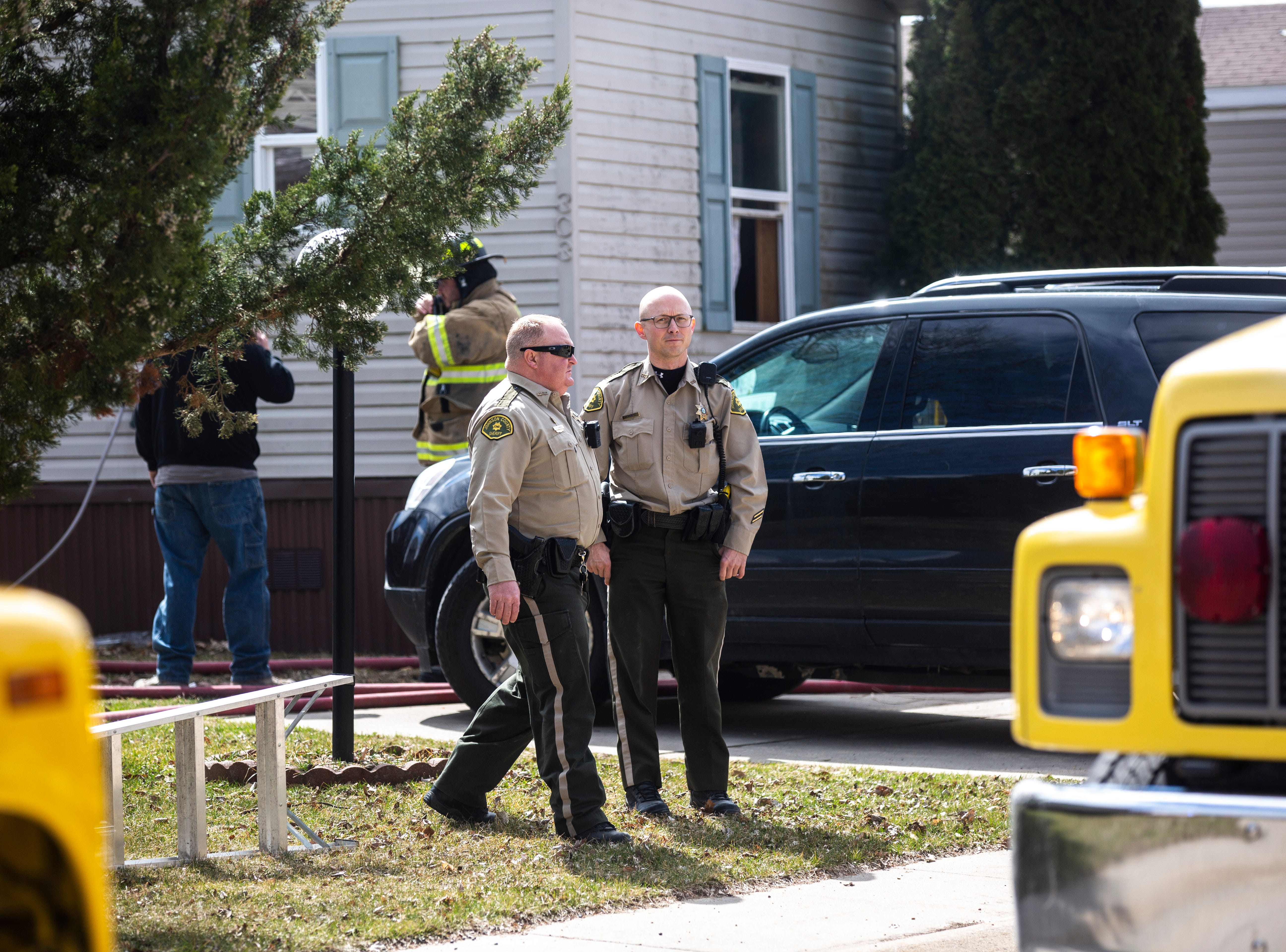 Johnson County sheriffs work with firefighters to respond to a kitchen fire on Tuesday, April 2, 2019, in the 300 block of Mosswood Lane at the Lake Ridge mobile home park in Iowa City, Iowa.