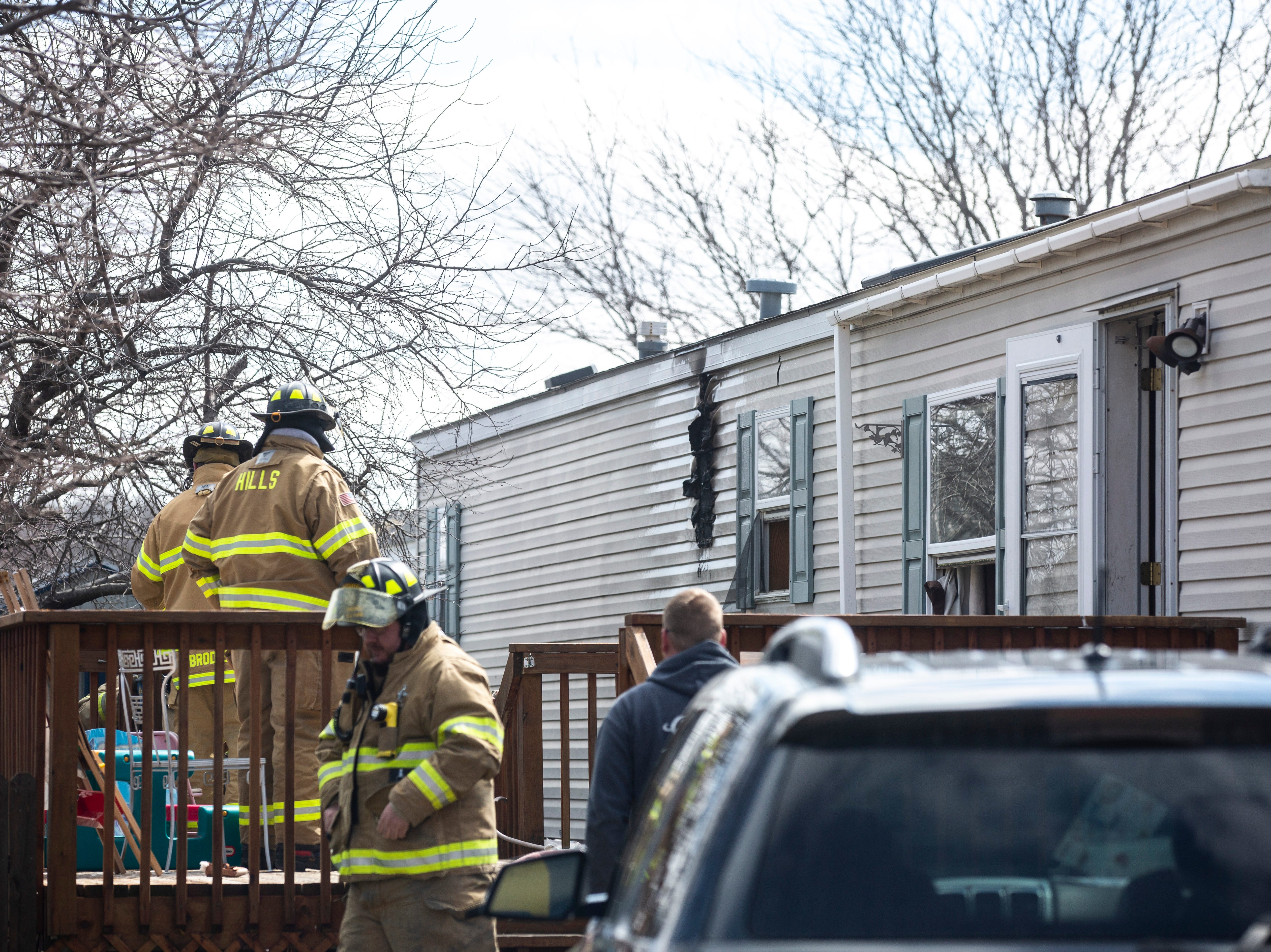 Firefighters respond to a kitchen fire on Tuesday, April 2, 2019, in the 300 block of Mosswood Lane at the Lake Ridge mobile home park in Iowa City, Iowa.