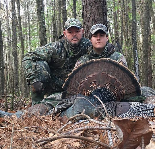 Pictured with his son Buck McKinion, Johnny McKinion said hunting will always be a tradition in his family.
