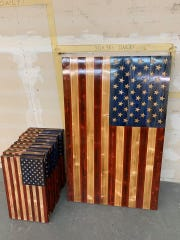Finished handmade wooden flags lean against a wall at the Rustic Flag Company, based in Trenton, Tenn. Owner Justin Scott posted this picture on the company's Facebook page on Feb. 22 along with a plea for patience as the company continues to fill orders.