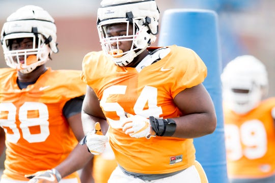 Tennessee's Kingston Harris (54) does a drill during Tennessee spring football practice at Haslam Field in Knoxville, Tennessee on Tuesday, April 2, 2019.