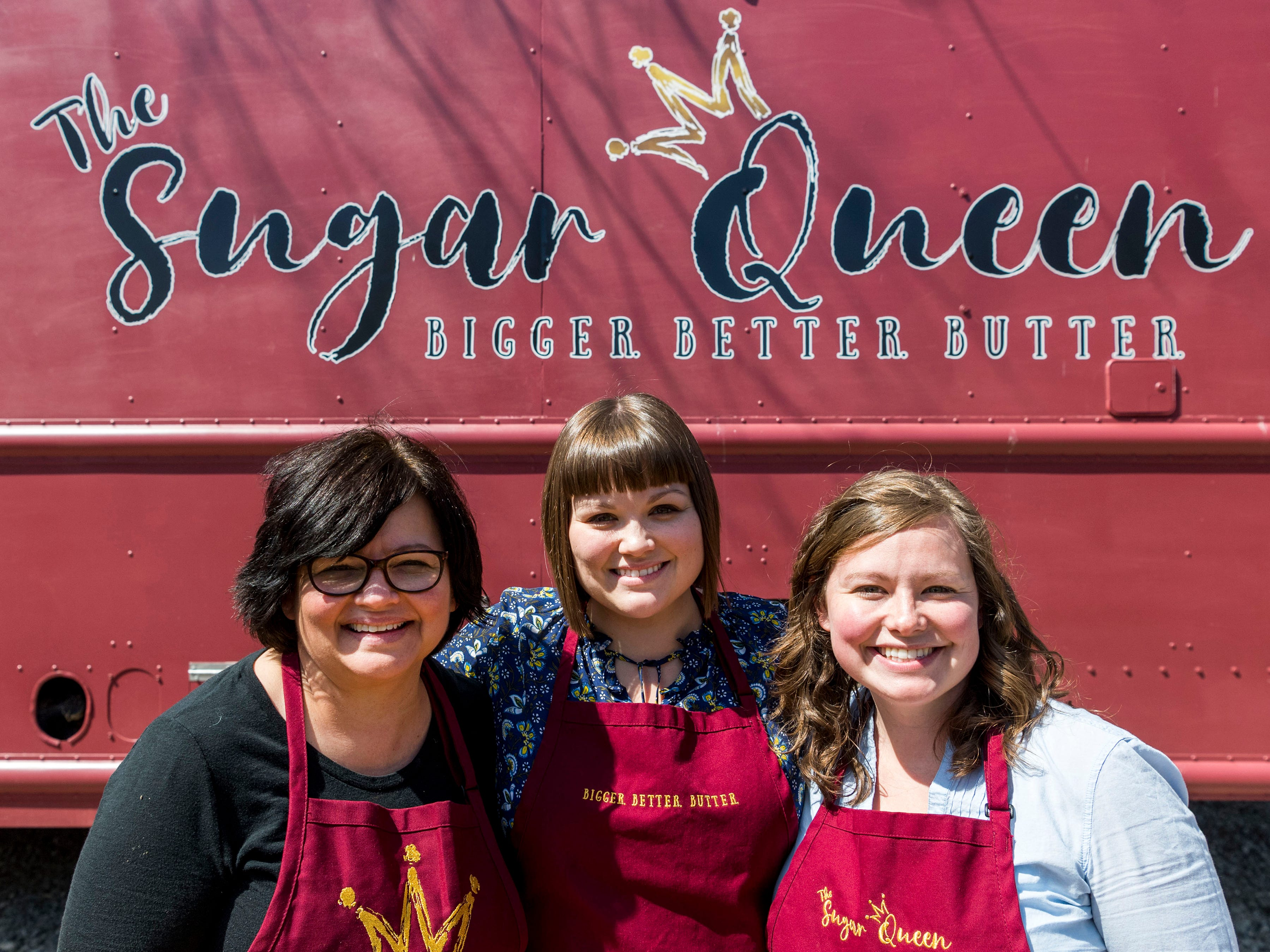 From left, Suvilla Gingerich, Lauri Gingerich and Staci Meyer with their food truck, The Sugar Queen, on Saturday, March 30, 2019.