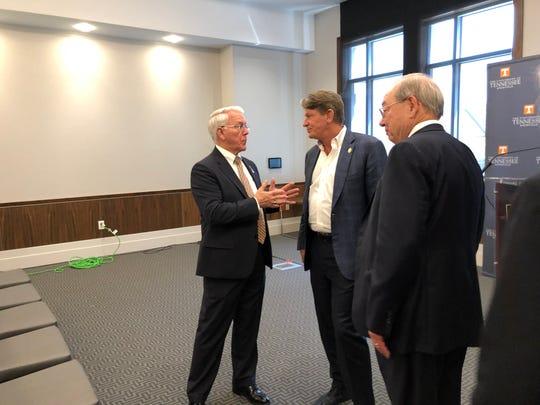 UT Knoxville interim Chancellor Wayne Davis, left, UT System President Randy Boyd and UT Knoxville's Postsecondary Education Research Center Director Jimmy Cheek speak April 2.