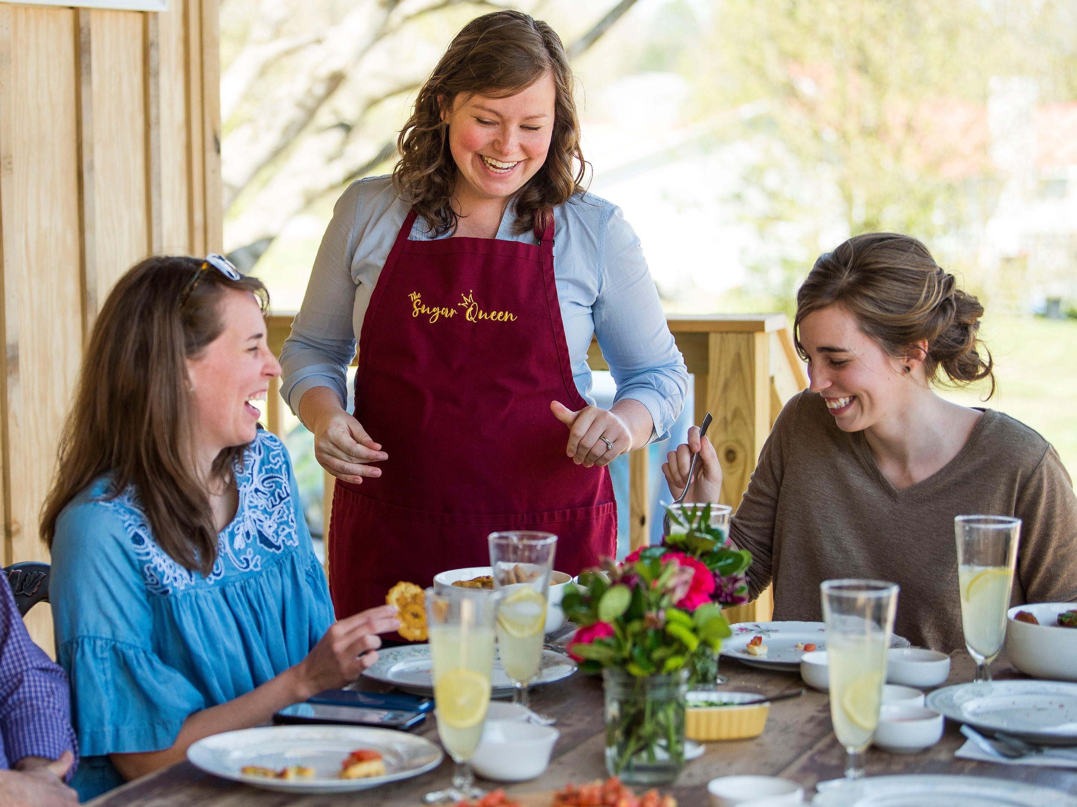 The Sugar Queen food truck's Staci Meyer, center, shares food made by the food truck during a wedding testing on Saturday, March 30, 2019.