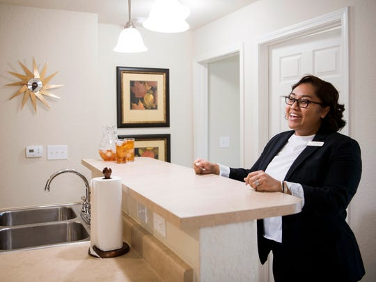 Amberleigh Bluff Apartments community director Lakenya Bowman gives a tour of a two bedroom apartment at the West Knoxville complex on Tuesday, April 2, 2019.