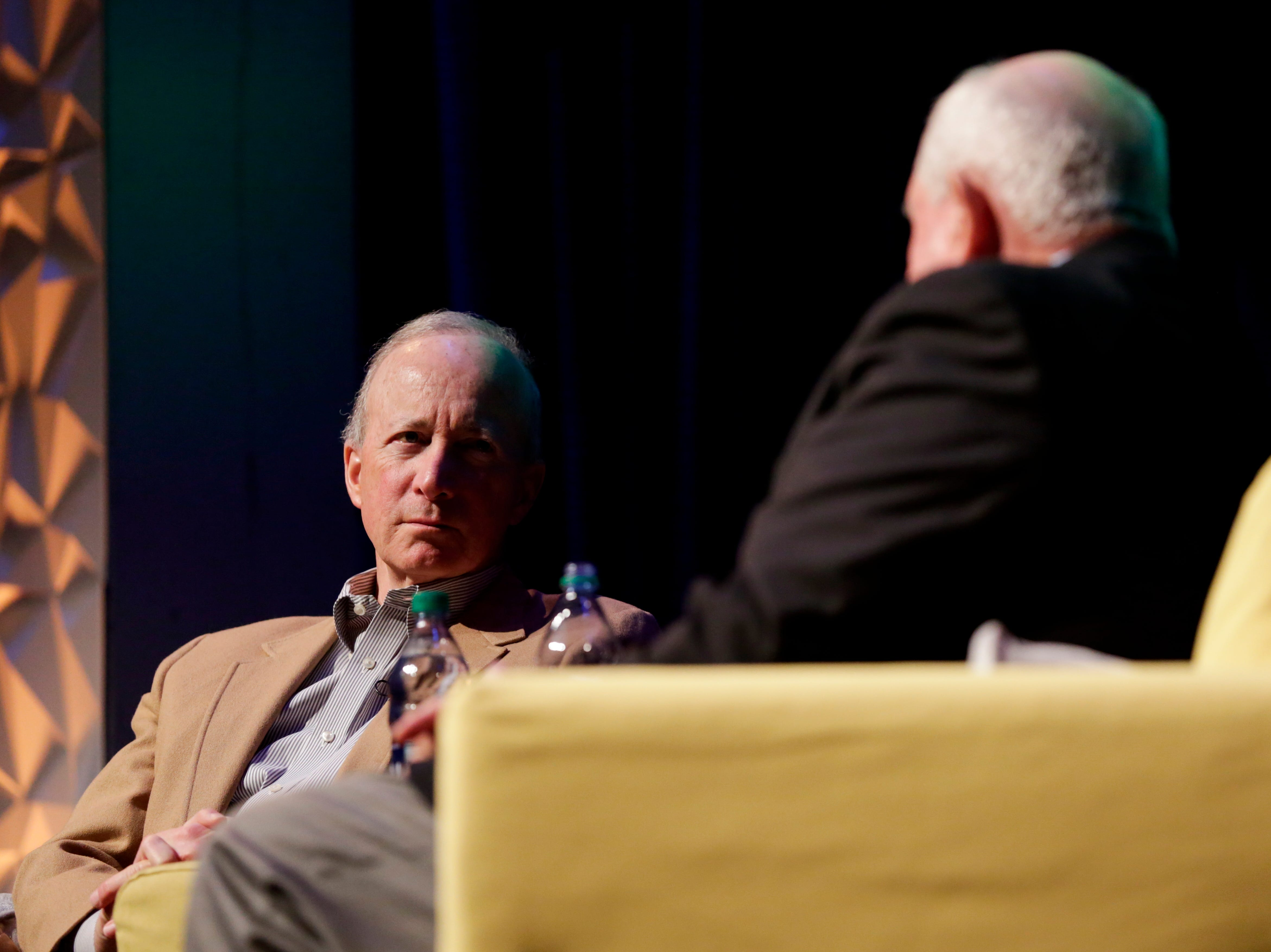 Purdue University president Mitch Daniels listens as U.S. Secretary of Agriculture Sonny Perdue speaks during a Ag Week Q&A conversation, Tuesday, April 2, 2019, at Purdue University in West Lafayette.