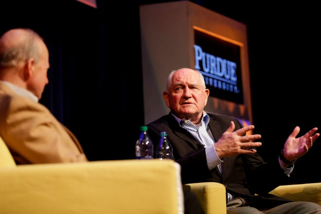 U.S. Secretary of Agriculture Sonny Perdue, right, speaks with Purdue University president Mitch Daniels during a Ag Week Q&A conversation, Tuesday, April 2, 2019, at Purdue University in West Lafayette.
