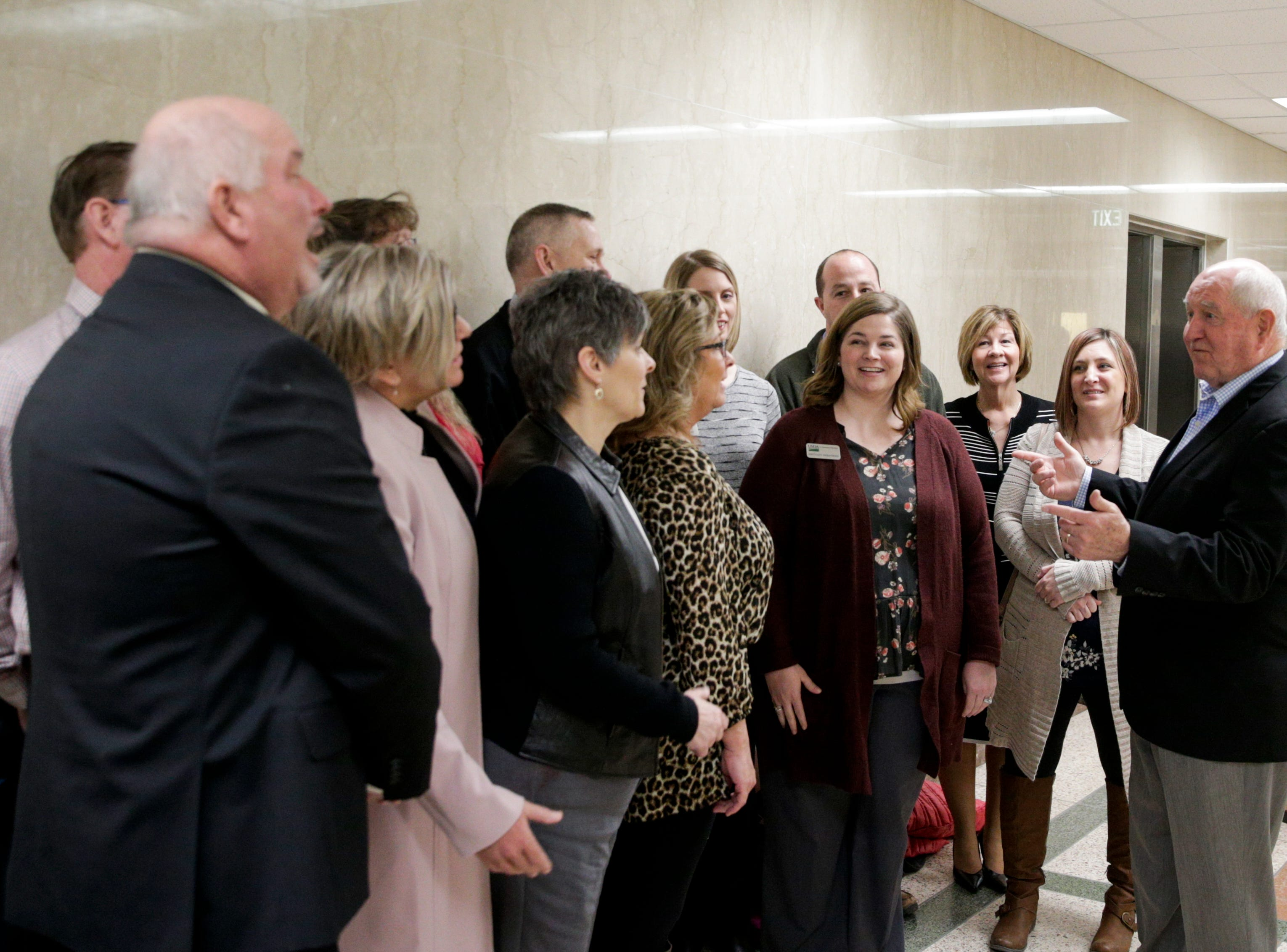 U.S. Secretary of Agriculture Sonny Perdue, right greets Department of Agriculture employees after speaking at an Ag Week Q&A conversation, Tuesday, April 2, 2019, at Purdue University in West Lafayette.