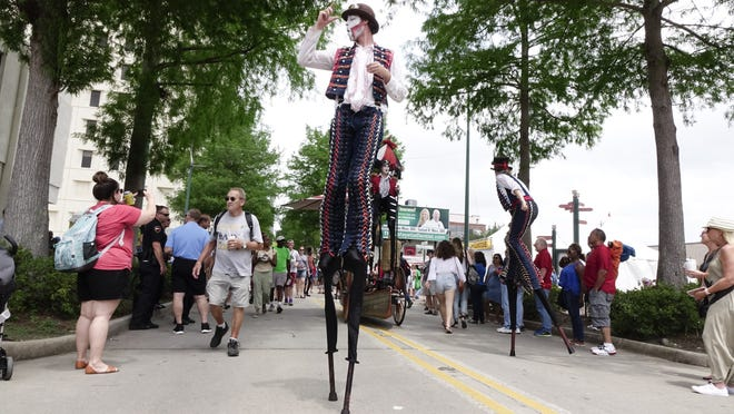 Stilt performers makew their way down Jefferson Street during Festival International de Louisiane in downtown Lafayette Sat., April 29, 2017.