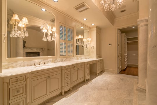 The master bath includes an enormous closet and tub surrounded by its own fireplace.