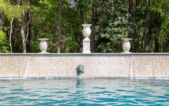 Marble sculptures add beautiful detail to the swimming pool.