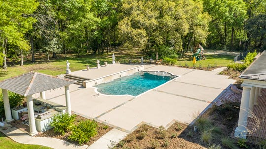 The pool area is surrounded by plenty of green space for family entertainment.