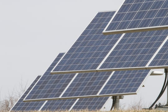 Solar panels shown Tuesday, April 2, 2019 are installed behind the Genoa Township Hall.