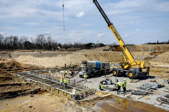 A construction crew works to pour concrete for the first portion of foundation at McLaren Greater Lansing's new 450 million hospital on Tuesday, April 2, 2019, in Lansing. The new health care campus is being developed on land acquired from the MSU Foundation in the foundation's University Corporate Research Park between Collins Road and US 127 south of Forest Road. The project, planned to open to patients by early 2022, will be the largest capital investment in McLaren's history, according to Greg Lane, its chief administrative officer.