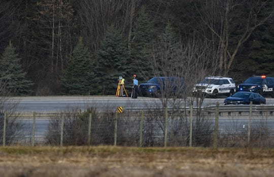 Emergency responders work at the scene of a fatal crash Tuesday morning, April 2, 2019, on U.S. 127 near the Interstate 96 interchange.