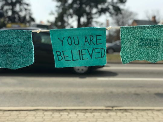 Teal prayer flags with messages of support for sexual assault survivors line Grand River Avenue. Once all the flags are up, there will be one for each of the 505 known survivors of former MSU sports doctor Larry Nassar's sexual abuse.
